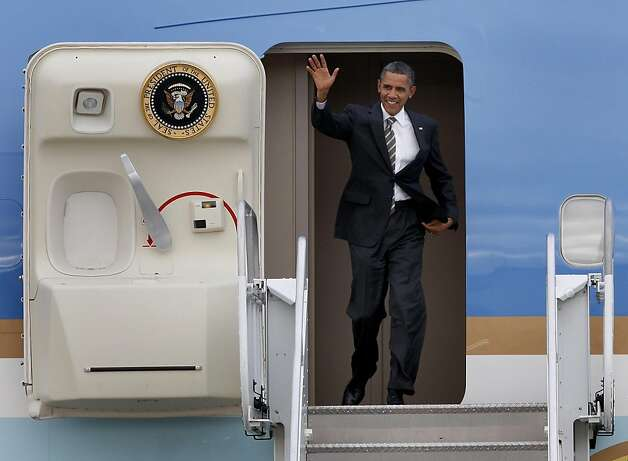 President Obama emerged from Air Force One with a smile. President Barack Obama arrived at Moffett Field in Mountain View, Calif. Sunday September 25, 2011 for a series of fundraisers and meetings. Photo: Brant Ward, The Chronicle