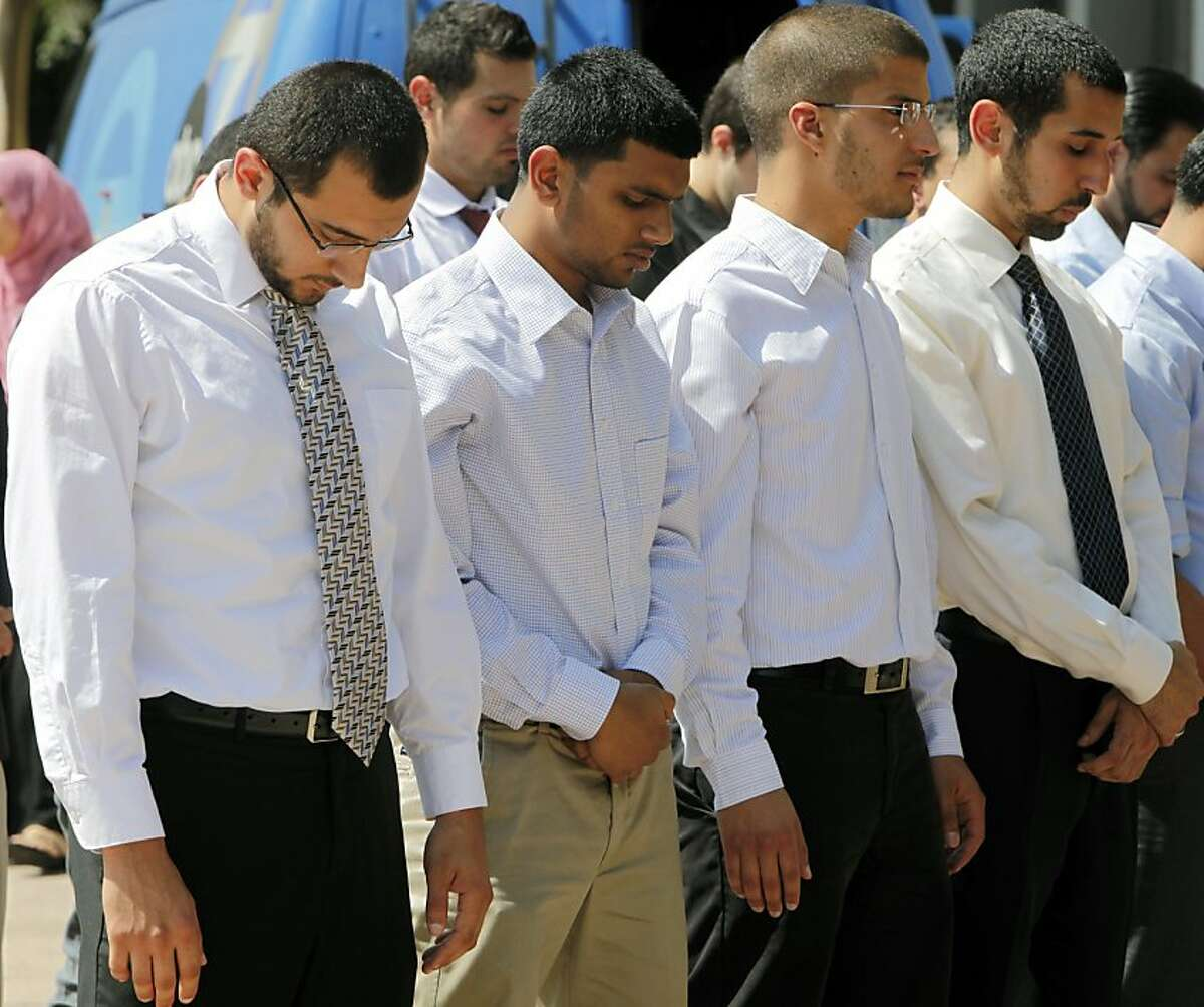 Four students, from left: Taher Herzallah, Mohammad Qureashi, Aslam Traina, and Mohamad Abdelgany pray outside court after being convicted of disrupting a speech by Israeli Ambassador Michael Oren, at the University of California, Irvine, last year, at the Central Justice Center court, Friday, Sept. 23, 2011 in Santa Ana, Calif. A California jury on Friday convicted 10 Muslim students of illegally disrupting Oren's speech in a case that has stoked an intense debate about free speech. (AP Photo/Damian Dovarganes)