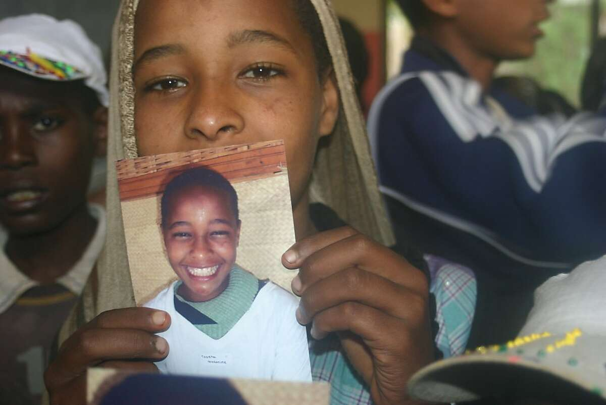 An Ethiopian girl with her class photo taken by Sammy novick of Mill Valley.