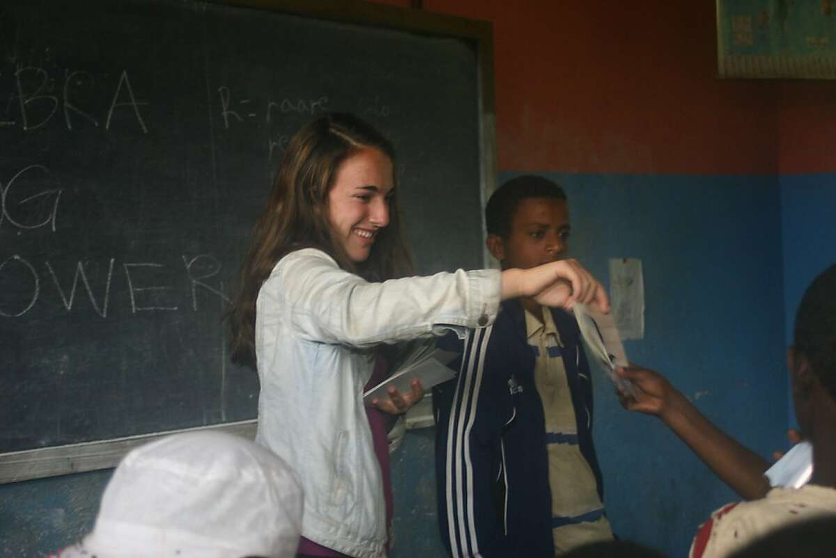 Sammy Novick of Mill Valley gives out class photos to kids in Ethiopia.
