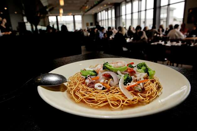Seafood with Crispy Egg Noodle, by Chef Charles Phan, on Tuesday January 26, 2009, of The Slanted Door, in San Francisco, whose restaurant is one of the most revered restaurants in the country. Phan a Vietnamese native left his country after the fall of Saigon coming to America with his family with nothing. Photo: Michael Macor, The Chronicle