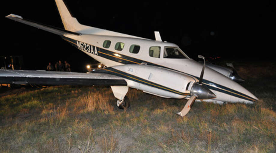 Federal investigators and Waller County sheriff's deputies are investigating a disabled airplane packed with marijuana that landed at a private corporate airport in Brookshire late Nov. 21. Photo: Waller County Sheriff's Office
