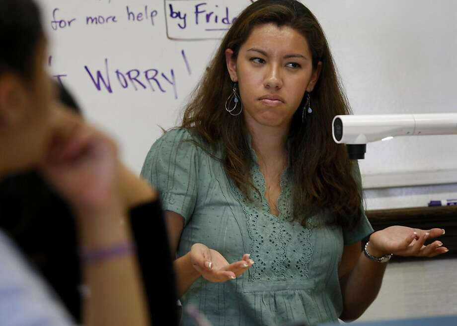 Stanford University student teacher Sabrina Silverman asks a question of students in math class. Mission High School in San Francisco, Calif. is experimenting with new math standards that make the  rigors of algebra and advanced math easier to understand. Photo: Brant Ward, The Chronicle