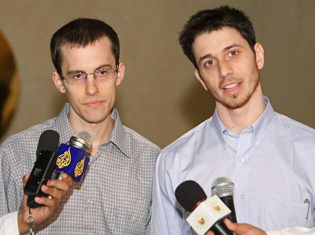 American hikers Shane Bauer (L) and Josh Fattal  hold a press conference after stepping off an Omani Royal Air Force plane on September 21, 2011 in Muscat, Oman, after Tehran released Bauer and Fattal on bail, months after handing them hefty jail terms.  The pair was released earlier September 21, 2011 from Tehran's notorious Evin prison, after more than two years in jail for spying and illegal entry into Iran, after the Gulf sultanate of Oman paid their bail.  Bauer and Fattal were arrested along with Sarah Shourd near the mountainous border with Iraq on July 31, 2009. All three have consistently maintained they innocently strayed into Iran while hiking in Iraq's Kurdistan region. Shourd was released last year on humanitarian and medical grounds.   AFP PHOTO / Mohammed MAHJOUB (Photo credit should read MOHAMMED MAHJOUB/AFP/Getty Images) Photo: Mohammed Mahjoub, AFP/Getty Images