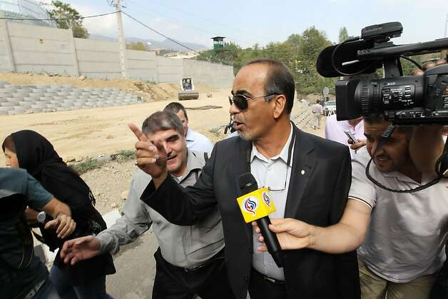 Iranian Masoud Shaffi the lawyer of the American hikers speaks with Journalists outside Tehran's Evin prison, on September 21, 2011. Two US hikers, Josh Fattal and Shane Bauer, both 29, jailed for spying and illegal entry into Iran from northern Iraq, were on their way home to the United States after Iran released them on bail, months after handing them hefty jail terms. AFP PHOTO/ATTA KENARE (Photo credit should read ATTA KENARE/AFP/Getty Images) Photo: Atta Kenare, AFP/Getty Images