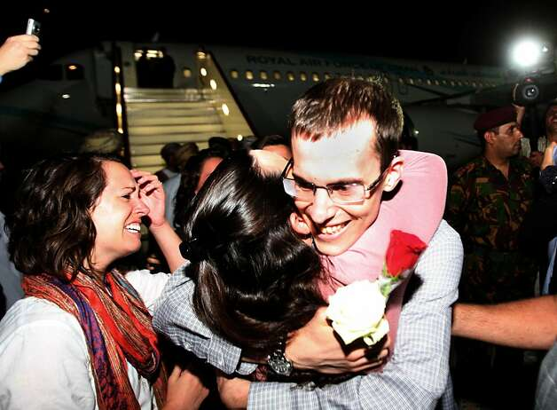 American hiker  Shane Bauer (R) is greeted on September 21, 2011 in Muscat, Oman, after Tehran released him and Josh Fattal (out of frame) on bail, months after handing them hefty jail terms.   The pair was released earlier September 21, 2011 from Tehran's notorious Evin prison, after more than two years in jail for spying and illegal entry into Iran, after the Gulf sultanate of Oman paid their bail.   AFP PHOTO / Mohammed MAHJOUB (Photo credit should read MOHAMMED MAHJOUB/AFP/Getty Images) Photo: Mohammed Mahjoub, AFP/Getty Images