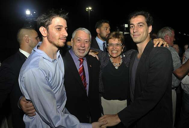 Freed American Josh Fattal, left, meets his relatives and friends upon his arrival from Iran, in Muscat, Oman Wednesday, Sept. 21, 2011. After more than two years in Iranian custody, two Americans convicted as spies took their first steps toward home Wednesday as they bounded down from a private jet and into the arms of family for a joyful reunion in the Gulf state of Oman. (AP Photo/Sultan Al-Hasani) Photo: Sultan Al-Hasani, AP
