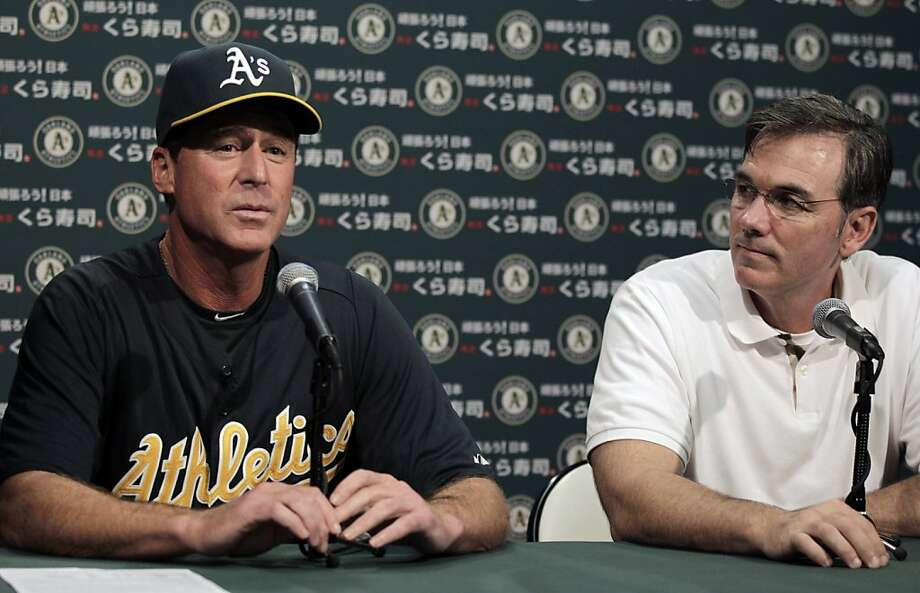 Oakland Athletics manager Bob Melvin, left, speaks beside A's general manager Billy Beane during a media conference Wednesday, Sept. 21, 2011, in Oakland, Calif. The Oakland Athletics have reached agreement on a three-year contract to keep Bob Melvin as their permanent manager. The 49-year-old Melvin took over in an interim capacity for the fired Bob Geren in June and has a 42-49 record after Tuesday night's 7-2 loss to the AL West-leading Texas Rangers at the Coliseum. Geren's dismissal marked the first time Oakland fired a manager during the season in a quarter century. (AP Photo/Ben Margot) Photo: Ben Margot, AP
