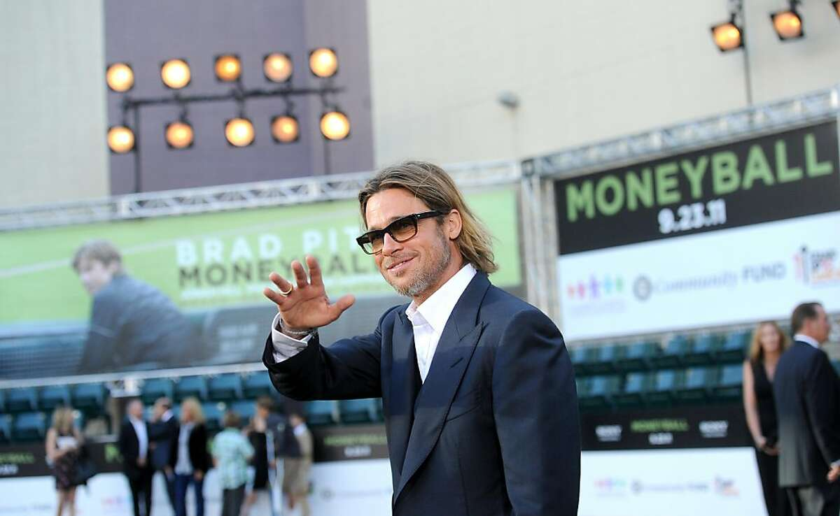"""Brad Pitt arrives for the world premiere of """"Moneyball"""" at the Paramount Theatre on Monday, Sept. 19, 2011, in Oakland, Calif."""