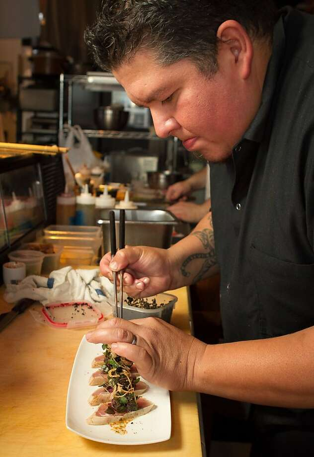 Chef Tim Archuleta puts the final touches on the Tuna Tataki at Ichi Sushi in San Francisco, Calif., on September 16th, 2011. Photo: John Storey, Special To The Chronicle