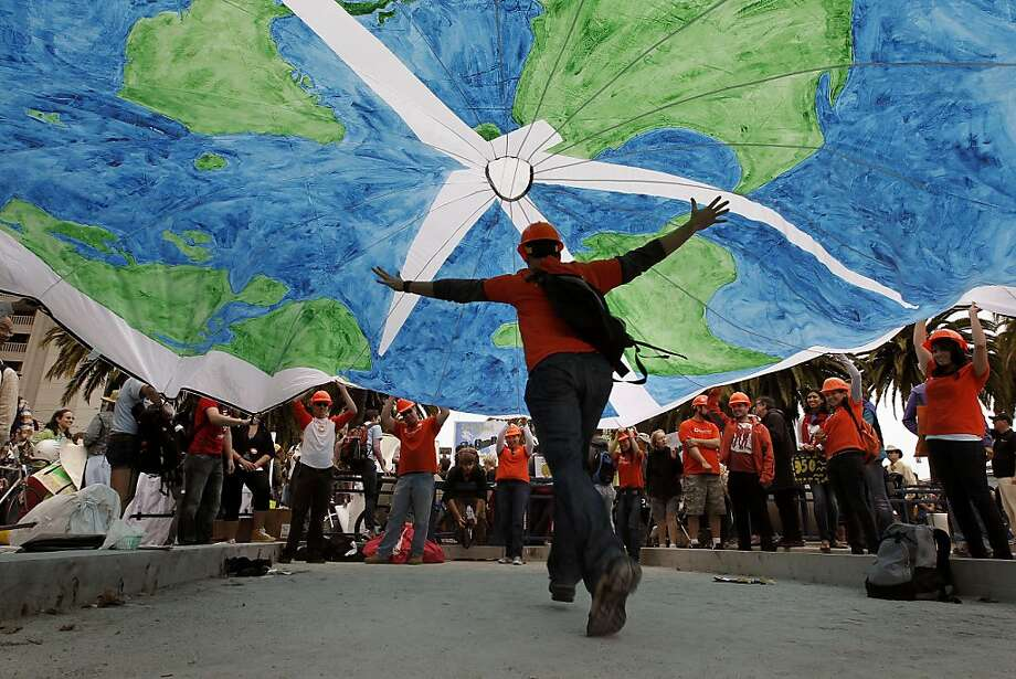 "People with the solar company ""Sungevity"", take turns running under a parachute globe they brought along, as they joined hundreds for a  parade and rally for ""Moving Planet"" demanding solutions to climate change, peace and sustainability,  in San Francisco, Ca., on Saturday September 24, 2011. Photo: Michael Macor, The Chronicle"