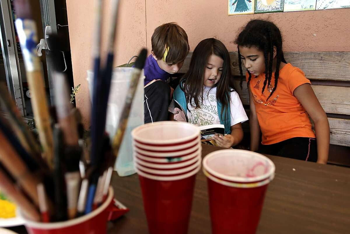 Henry J. Kaiser Kaiser Elementary students Leeam Levy, 7, Luna Scott-Chung and Zindzhi Montgomery, 7 read after school on Friday September 23, 2011, in Oakland, Ca. Henry J. Kaiser Elementary in the Oakland hills, could be on the list of schools the superintendent will recommend for closure at a meeting next Tuesday evening.
