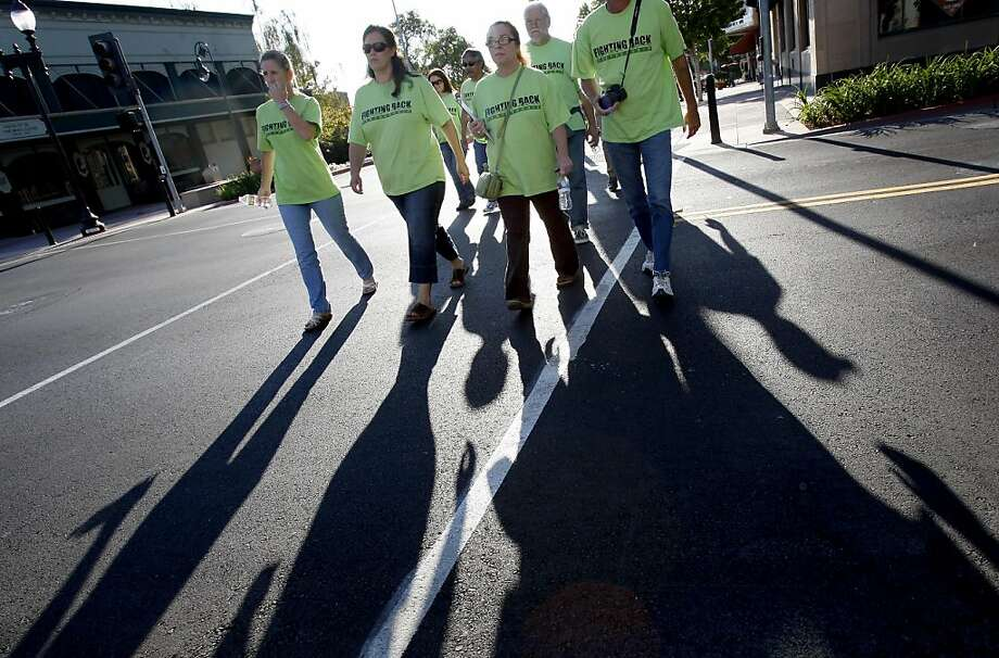 "A group of local citizens wearing green ""Fighting Back"" t-shirts walked across Marin Street in effort to scare of prostitution and report crimes to the police. Citizen groups in Vallejo, Calif. have been credited with reducing street crime and prostitution on Sonoma Blvd. and Marin Street. Photo: Brant Ward, The Chronicle"
