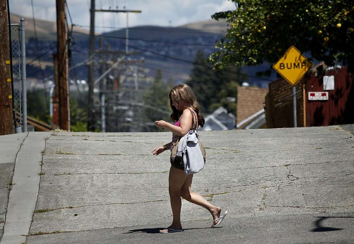 Alexis walks Marin Street in Vallejo keeping an eye on her smart phone. An area in Vallejo, Calif. bordered by Sonoma and Marin Streets has been a known area for prostitution. One of the girls, Alexis, is trying to turn her life around.