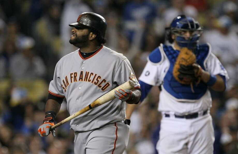 LOS ANGELES, CA - SEPTEMBER 20: Pinch hitter Pablo Sandoval #48 of the San Francisco Giants reacts after striking out in the eighth inning against the Los Angeles Dodgers on September 20, 2011 at Dodger Stadium in Los Angeles, California.  (Photo by Stephen Dunn/Getty Images) Ran on: 09-21-2011 Pablo Sandoval heads back to the dugout after striking out as a pinch-hitter against L.A. reliever Kenley Jansen. Photo: Stephen Dunn, Getty Images