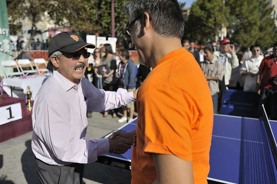 Mayor Ed Lee after finishing a ping pong game in Chinatown as part of the Sunday Streets event in Portsmouth Square. Photo: David Butow, Special To The Chronicle