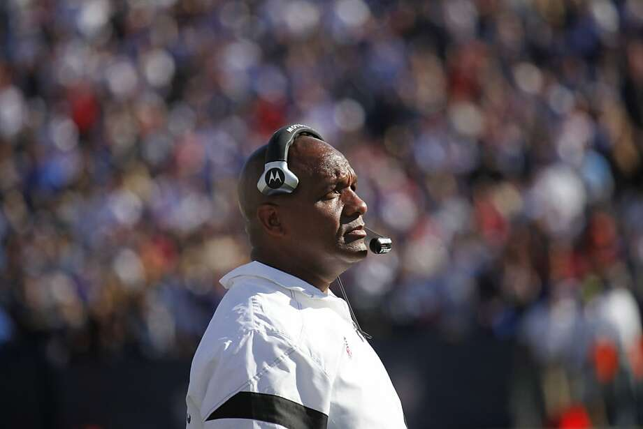 Oakland Raiders head coach Hue Jackson looks up at the scoreboard during the fourth quarter of an NFL football game in Orchard Park, N.Y., Sunday, Sept. 18, 2011. (AP Photo/Derek Gee) Photo: Derek Gee, AP