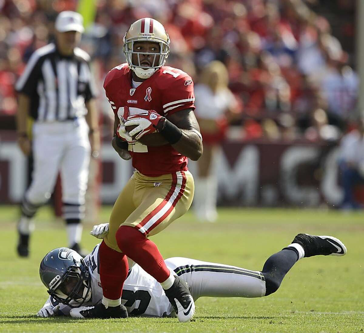 San Francisco 49ers wide receiver Braylon Edwards (17) runs away from Seattle Seahawks defensive back Marcus Trufant (23) in the fourth quarter of an NFL football game in San Francisco, Sunday, Sept. 11, 2011. (AP Photo/Marcio Jose Sanchez)