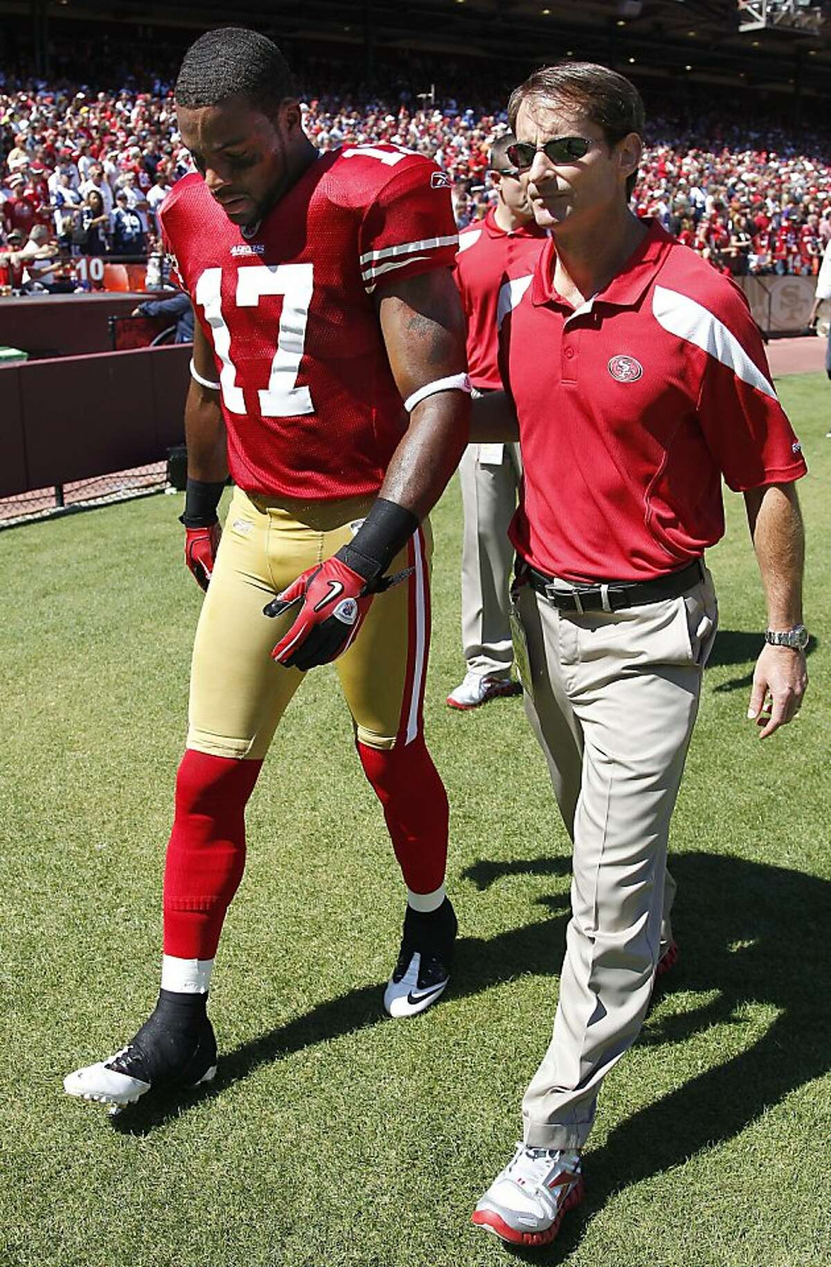 FILE - This Sept.. 18, 2011 file photo shows San Francisco 49ers wide receiver Braylon Edwards (17) being escorted off the field after being injured in the first half of an NFL football game against the Dallas Cowboys, in San Francisco. The 49ers have questions in their receiving corps as they hit the road for the first time ahead of Sunday's game at Cincinnati. (AP Photo/Tony Avelar, File) Ran on: 09-22-2011 Braylon Edwards could be out for about a month with a torn meniscus.