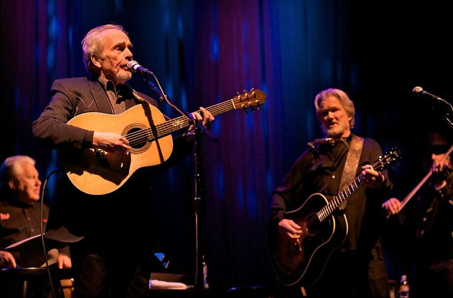 Merle Haggard & Kris Kristofferson's special concert at the Wells Fargo Center in Santa Rosa on April 1, 2009.  Ran on: 04-03-2009 Merle Haggard (left) seemed to overcome his initial skepticism over fellow songwriter Kris Kristofferson's suggestion that they perform together on acoustic guitars. Photo: Steve Jennings, Special To The Chronicle