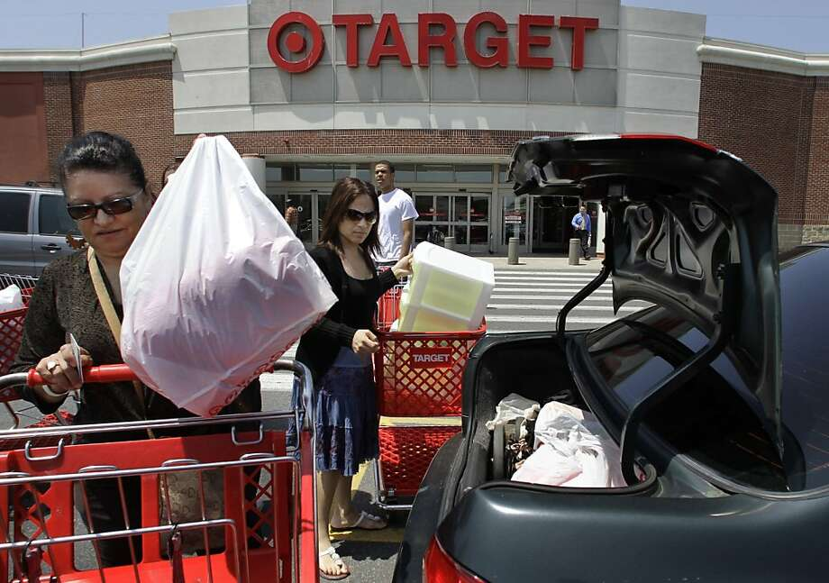 FILE - In this file photograph taken June 2, 2010, shoppers Joselin Pena, left, and her niece Ingrid Romero, center, both of Boston, load packages into their car after shopping at a Target location, in Boston. A monthly consumer survey shows that Americans' confidence in the economy eroded further in July amid job worries. The reading raises concern about the economic recovery and the back-to-school shopping season.(AP Photo/Steven Senne, file)  Ran on: 07-28-2010 Joselin Pena (left) and niece Ingrid Romero, both of Boston, buck the consumer confidence downward trend as they load their purchases. Photo: Steven Senne, AP