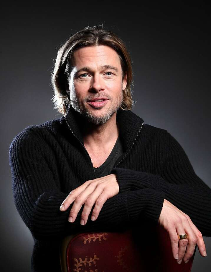 "In this Sept. 10, 2011 photo, actor Brad Pitt poses for a portrait to promote his film ""Moneyball"" during the 36th Toronto International Film Festival in Toronto, Canada. Two-time Oscar nominee Brad Pitt came to Toronto with his baseball tale ""Moneyball,"" putting in a flamboyant performance as iconoclastic Oakland A's general manager Billy Beane. (AP Photo/Carlo Allegri) Photo: Carlo Allegri, AP"