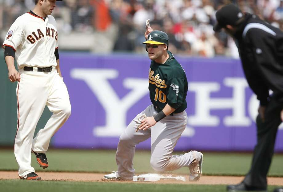 Oakland Athletics' Daric Barton steals 2nd. As the San Francisco Giants take on the Oakland Athletics at AT&T Park in San Francisco, Calif., on Sunday, May 22, 2011. Photo: Thomas Levinson, The Chronicle