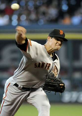 San Francisco Giants' Joe Martinez delivers a pitch in the third inning against the Houston Astros in a baseball game Wednesday, Aug. 5, 2009 in Houston. (AP Photo/Pat Sullivan) Ran on: 08-06-2009 Joe Martinez pitched his first big-league game since getting hit by a line drive in April. Ran on: 08-06-2009 Joe Martinez pitched his first big-league game since getting hit by a line drive in April. Photo: Pat Sullivan, AP