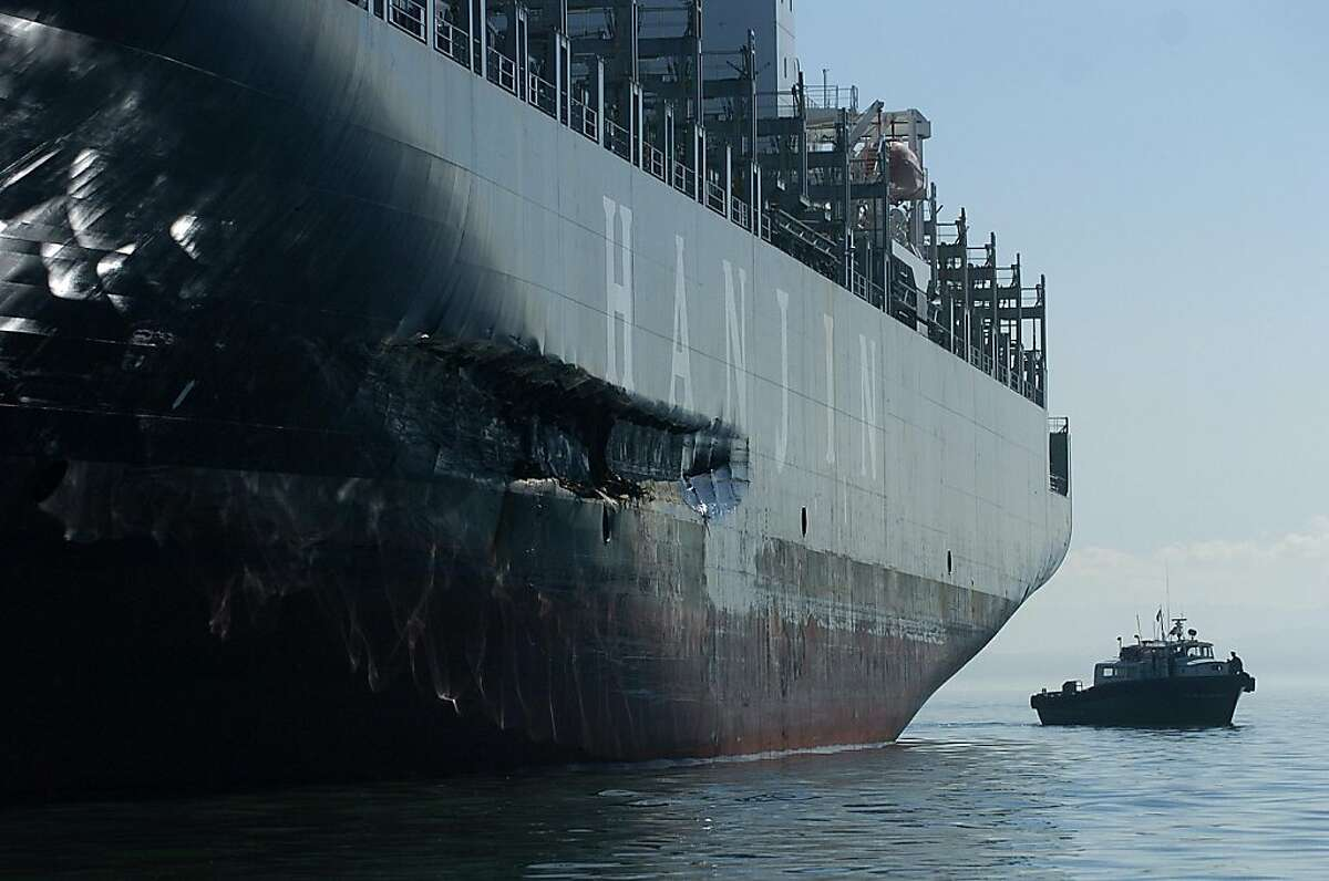 busan_nb6 An approximately 90-foot long gash stretches down the Cosco Busan's hull as it rests at anchor on Tuesday, Nov. 13, 2007, in the San Francisco Bay, Calif. The vessel struck the Bay Bridge last Wednesday spilling about 58,000 gallons of oil into the bay. BY NOAH BERGER/SPECIAL TO THE CHRONICLE. EDITOR: DO NOT RELEASE TO ANY WIRE OR OTHER NEWSPAPER. CHRONICLE USE ONLY.