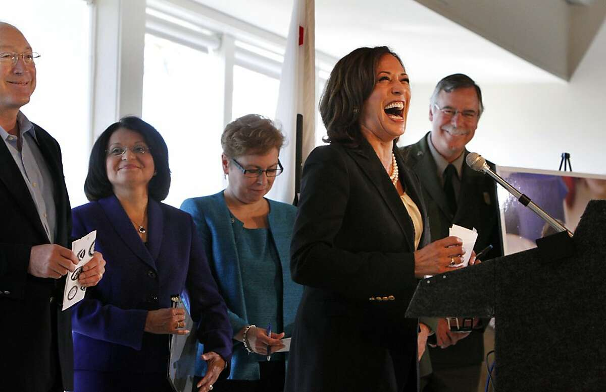 Attorney General, Kamala Harris introduces United States Interior, Ken Salazar, left, during a press conference, Monday September 19, 2011, at Treasure Island in San Francisco, Calif. They were among other leaders announcing a settlement requiring the owners and operators of the M/V Cosco Busan to pay $44.4 million for damages which occurred when the vessel struck the Bay Bridge spilling 53,000 gallons of oil, November 7, 2007.