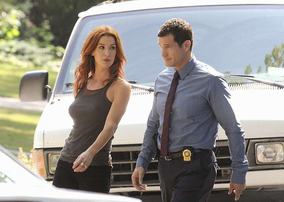 ÒHeroesÓ --  Carrie Wells (Poppy Montgomery) and Al Burns (Dylan Walsh) discuss possible leads in their latest investigation into the murder of a married couple, on UNFORGETTABLE, Tuesday, Sept. 27 (10:00-11:00, ET/PT) on the CBS Television Network. Photo: Heather Wines, CBS
