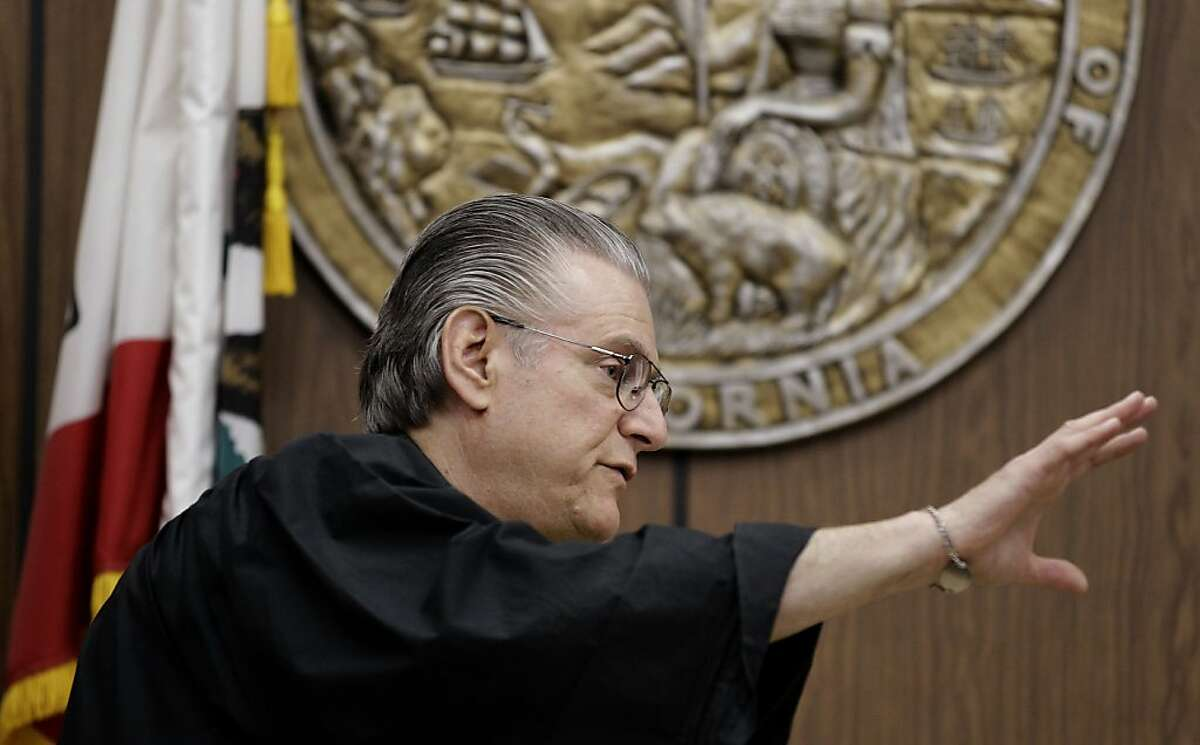 """Alameda County Superior Court Judge Gary Picetti gestures in court Thursday, Sept. 8, 2011, at the Hayward Hall of Justice in Hayward, Calif. Giselle Esteban is accused of killing her former high school friend Michelle Le, 26, whose body has not been found. Esteban, 27, who is pregnant, was scheduled to appear at the Hayward Hayward Hall of Justice this afternoon but had a medical issue believed to be """"somehow related to her pregnancy,"""" said Judge Gary Picetti of Alameda County Superior Court. If she is cleared by doctors she will appear in court Friday, the judge said. (AP Photo/Ben Margot)"""