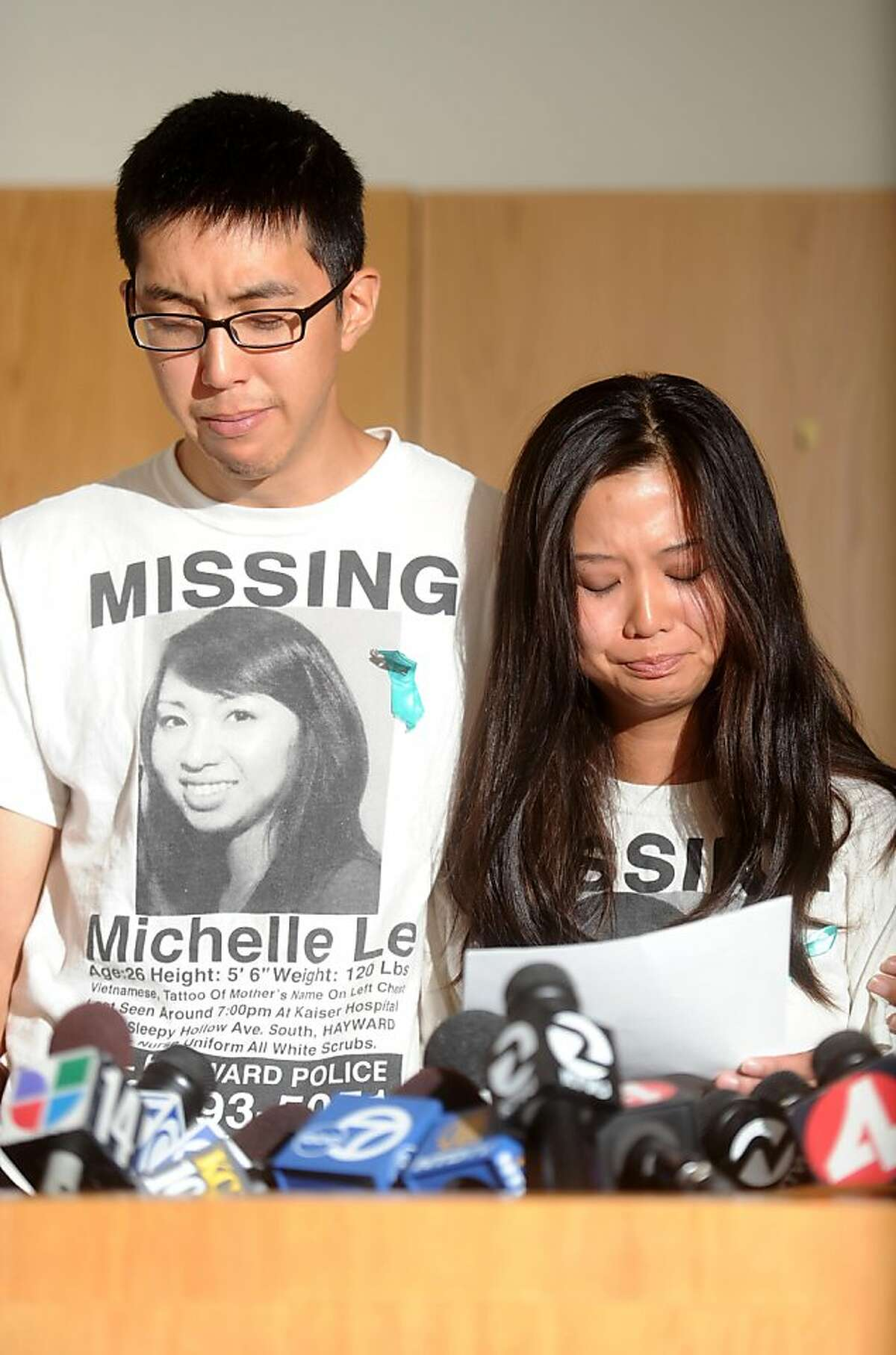 Michael Le and his cousin Krystine Dinh choke back tears during a news conference Wednesday, Sept. 7, 2011, in Hayward, Calif. Police announced they have arrested Giselle Esteban on suspicion of murdering Michael's sister Michelle Le, a nursing student who disappeared in May.