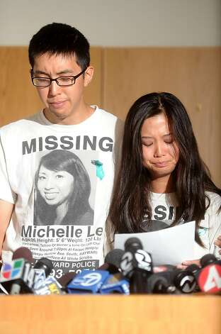 Michael Le and his cousin Krystine Dinh choke back tears during a news conference Wednesday, Sept. 7, 2011, in Hayward, Calif. Police announced they have arrested Giselle Esteban on suspicion of murdering Michael's sister Michelle Le, a nursing student who disappeared in May. Photo: Noah Berger, Special To The Chronicle