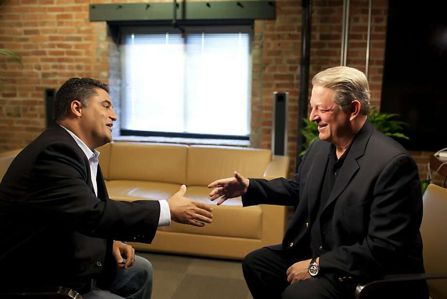 "In this undated image released by Current TV, former Vice President and Current Chairman and co-founder Al Gore, right, speaks with Cent Uygur during an interview for Uygur's online show ""The Young Turks,"" in San Francisco, Calif.  The network announced, Tuesday, Sept. 20, 2011, that Uygur's show will be added to their prime-time lineup later this year. (AP Photo/Current TV) Photo: AP"
