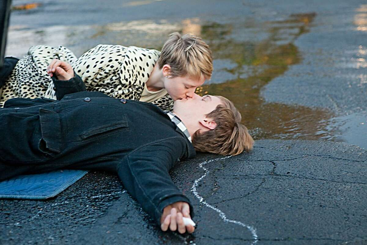 Left to Right: Mia Wasikowska as Annabel and Henry Hopper as Enoch in,