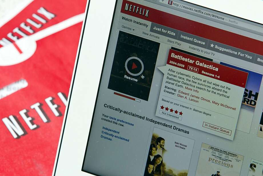 Netflix Inc.'s streaming service is displayed on a computer monitor along with Netflix envelopes in New York, U.S., on Thursday, Sept. 15, 2011. Netflix Inc., the mail-order and online film-rental service, fell the most in almost three years after cutting its forecast for U.S. subscribers in the third quarter. Photographer: Jin Lee/Bloomberg Photo: Jin Lee, Bloomberg