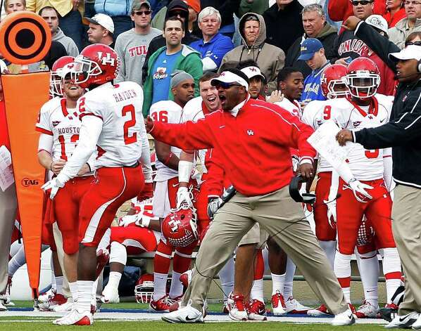 Houston head coach Kevin Sumlin reacts on the sidelines after defensive back D.J. Hayden (2) broke up a Tulsa pass play in the fourth quarter of an NCAA college football game in Tulsa, Okla., Friday, Nov. 25, 2011. Houston won 48-16. Photo: AP