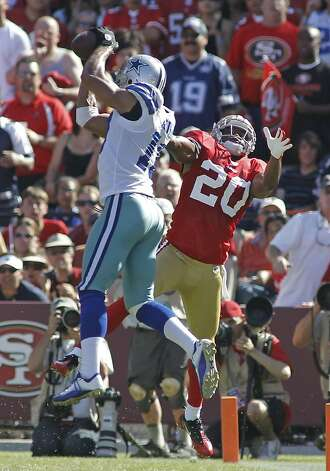 Dallas Cowboys wide receiver Miles Austin (19) snags a pass over San Francisco 49ers free safety Madieu Williams (20) in the 4th quarter. The Dallas Cowboys defeated the San Francisco 49ers, 27-24 in overtime at Candlestick Park in San Francisco, California on Sunday, September 18, 2011. (Paul Moseley/Fort Worth Star-Telegram/MCT) Photo: Paul Moseley, MCT