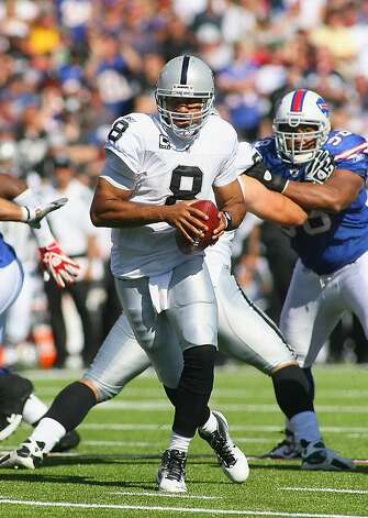ORCHARD PARK, NY - SEPTEMBER 18:  Jason Campbell #8 of the Oakland Raiders drops back to pass against the Buffalo Bills at Ralph Wilson Stadium on September 18, 2011 in Orchard Park, New York.  (Photo by Rick Stewart/Getty Images) Photo: Rick Stewart, Getty Images