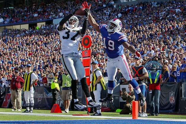 ORCHARD PARK, NY - SEPTEMBER 18: Chris Johnson #37 of the Oakland Raiders misses intercepting a pass intended for Donald Jones #19 of the Buffalo Bills at Ralph Wilson Stadium on September 18, 2011 in Orchard Park, New York. (Photo by Tom Szczerbowski/Getty Images) Photo: Tom Szczerbowski, Getty Images