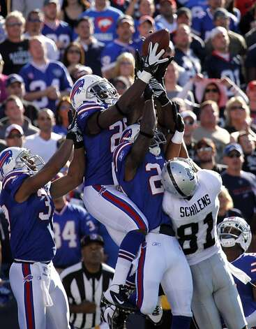 Buffalo Bills' Da'Norris Searcy (25) intercepts the ball in the end zone over Oakland Raiders' Chaz Schilens (81) on the final play of the game to defeat the Oakland Raiders during the fourth quarter of an NFL football game in Orchard Park, N.Y., Sunday, Sept. 18, 2011. (AP Photo/Derek Gee) Photo: Derek Gee, AP