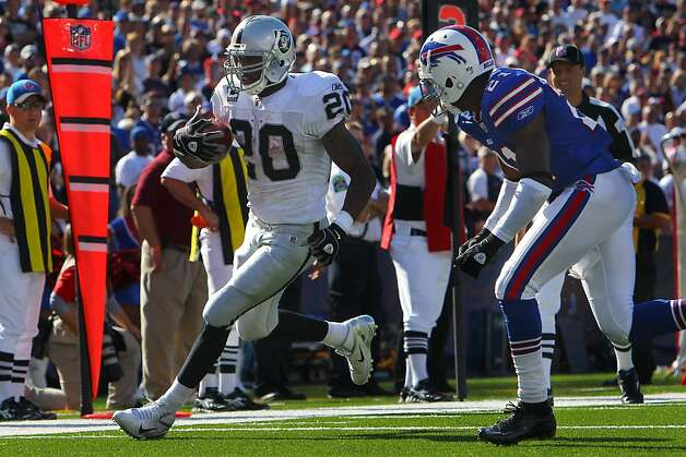 ORCHARD PARK, NY - SEPTEMBER 18: Darren McFadden #20 of the Oakland Raiders rushes for a touchdown during an NFL game against the Buffalo Bills at Ralph Wilson Stadium on September 18, 2011 in Orchard Park, New York. (Photo by Tom Szczerbowski/Getty Images) Photo: Tom Szczerbowski, Getty Images