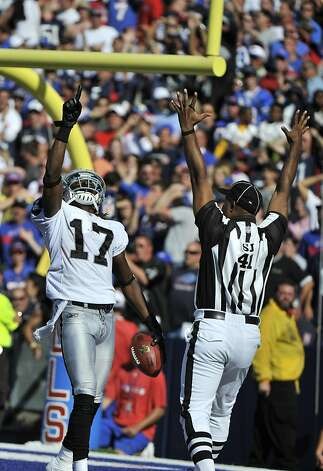 Oakland Raiders' Denarius Moore (17) celebrates his touchdown during the second half of an NFL football game against the Buffalo Bills in Orchard Park, N.Y., Sunday, Sept. 18, 2011. The Bills won 38-35. (AP Photo/Gary Wiepert) Photo: Gary Wiepert, AP