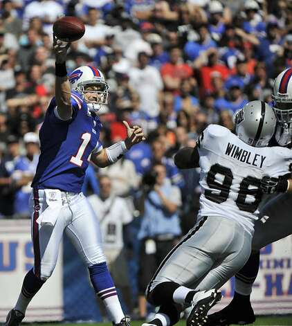 Buffalo Bills' Ryan Fitzpatrick throws against the Oakland Raiders during the first half of an NFL football game in Orchard Park, N.Y., Sunday, Sept. 18, 2011. (AP Photo/Gary Wiepert) Photo: Gary Wiepert, AP