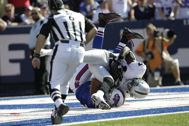 Oakland Raiders' Denarius Moore (17) makes a touchdown catch under pressure from George Wilson (37)during the second half of an NFL football game in Orchard Park, N.Y., Sunday, Sept. 18, 2011. The Bills won 38-35. (AP Photo/David Duprey) Photo: David Duprey, AP