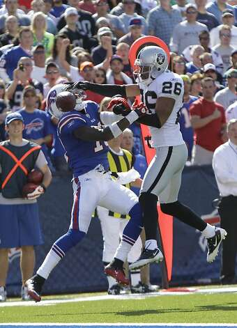 Oakland Raiders' Stanford Routt (26) breaks up a pass intended for Buffalo Bills' Stevie Johnson (13) during the second half of an NFL football game in Orchard Park, N.Y., Sunday, Sept. 18, 2011. The Bills won 38-35. (AP Photo/David Duprey) Photo: David Duprey, AP