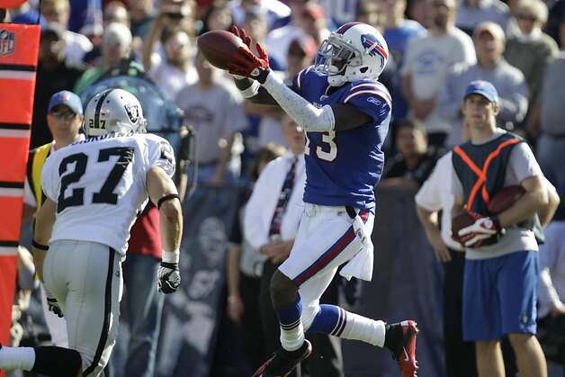 Buffalo Bills' Stevie Johnson (13) makes a catch under pressure from Oakland Raiders' Matt Giordano (27) during the second half of an NFL football game in Orchard Park, N.Y., Sunday, Sept. 18, 2011. The Bills won 38-35. (AP Photo/David Duprey) Photo: David Duprey, AP