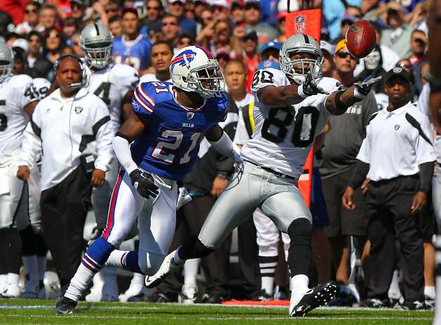 ORCHARD PARK, NY - SEPTEMBER 18: Derek Hagan #80 of the Oakland Raiders catches a pass during an NFL game as Leodis McKelvin #21 of the Buffalo Bills defends at Ralph Wilson Stadium on September 18, 2011 in Orchard Park, New York. (Photo by Tom Szczerbowski/Getty Images) Photo: Tom Szczerbowski, Getty Images