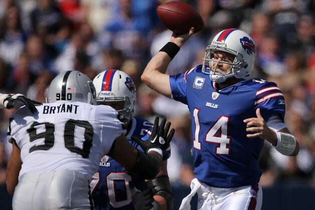 ORCHARD PARK, NY - SEPTEMBER 18: Ryan Fitzpatrick #14 of the Buffalo Bills throws a pass during an NFL game against the Oakland Raiders at Ralph Wilson Stadium on September 18, 2011 in Orchard Park, New York. (Photo by Tom Szczerbowski/Getty Images) Photo: Tom Szczerbowski, Getty Images